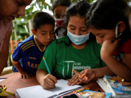 Denisse Toala (C), a 16-year-old student, teaches children in an improvised school she has set up under a tree since they have been unable to attend virtual classes in the low-income neighbourhood Realidad de Dios, during the outbreak of the coronavirus disease (COVID-19), in Guayaquil, Ecuador July 2, 2020. REUTERS/Santiago Arcos