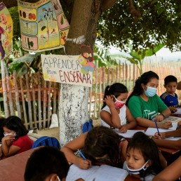 Denisse Toala (3rd R, green shirt), a 16-year-old student, teaches children in an improvised school she has set up under a tree since they have been unable to attend virtual classes in the low-income neighbourhood Realidad de Dios, during the outbreak of the coronavirus disease (COVID-19), in Guayaquil, Ecuador July 2, 2020. REUTERS/Santiago Arcos