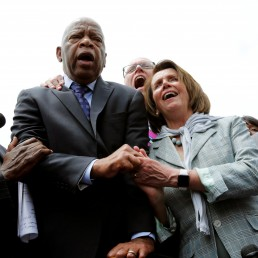 U.S. House Minority Leader Nancy Pelosi (D-CA) (2nd R) holds hands with Rep. John Lewis (D-GA) (2nd L) as they sing along with House Democrats after their sit-in over gun-control law on Capitol Hill in Washington, U.S., June 23, 2016. REUTERS/Yuri Gripas