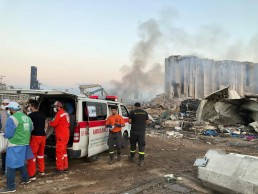 Members of Turkey's Humanitarian Relief Foundation (IHH) help a local rescue team at the site of Tuesday's blast in Beirut's port area, Lebanon August 5, 2020. Humanitarian Relief Foundation (IHH)/Handout via REUTERS