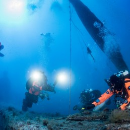 Volunteer divers of the environmental group Ghost Diving work near the WWII wreck of the HMS Perseus, off the island of Kefalonia, Greece, July 26, 2020. Cor Kuyvenhoven/Ghost Diving/Handout via REUTERS