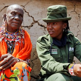 Sharon Karaine, member of Team Lioness, an all-female Kenyan ranger unit, talks to her grandmother Ntangile Minchil after arriving home from the Risa camp, where she stayed due to the coronavirus disease (COVID-19) outbreak, within the Olgulului conservancy in Amboseli, Kenya August 8, 2020. Picture taken August 8, 2020. REUTERS/Njeri Mwangi