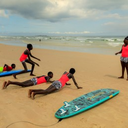 Khadjou Sambe, 25, Senegal's first female professional surfer, trains beginners with Black Girls Surf (BGS), a training school for girls and women who want to compete in professional surfing, on the sand at Yoff beach, in Dakar, Senegal July 28, 2020. REUTERS/Zohra Bensemra