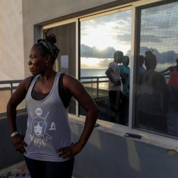 Khadjou Sambe, 25, Senegal's first female professional surfer, stands in front of beginners that she is coaching with Black Girls Surf (BGS), a training school for girls and women who want to compete in professional surfing, while conducting a fitness training session, in Ngor, Dakar, Senegal, July 28, 2020. REUTERS/Zohra Bensemra