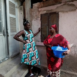 Khadjou Sambe, 25, Senegal's first female professional surfer, chats to her mother Koune Ba outside their house in Ngor, Dakar, Senegal, July 31, 2020. REUTERS/Zohra Bensemra