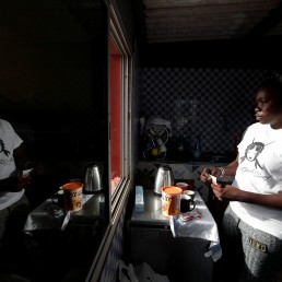 Khadjou Sambe, 25, Senegal's first female professional surfer, prepares breakfast at her coach Rhonda Harris's home, who is the founder of Black Girls Surf (BGS), a training school for girls and women who want to compete in professional surfing, in Ngor, Dakar, Senegal, July 29, 2020. REUTERS/Zohra Bensemra