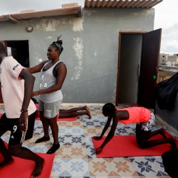 Khadjou Sambe, 25, Senegal's first female professional surfer, coaches young surfers during a fitness training session with Black Girls Surf (BGS), a training school for girls and women who want to compete in professional surfing, in Ngor, Dakar, Senegal July 28, 2020. REUTERS/Zohra Bensemra