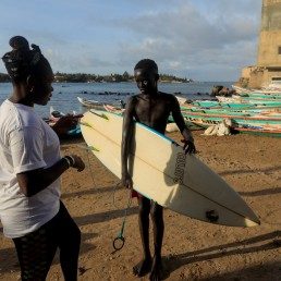 Khadjou Sambe, 25, Senegal's first female professional surfer, talks to a young surfer in Ngor, Dakar, Senegal, July 30, 2020. REUTERS/Zohra Bensemra