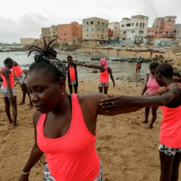 Khadjou Sambe, 25, Senegal's first female professional surfer, coaches beginners learning to surf with Black Girls Surf (BGS), a training school for girls and women who want to compete in professional surfing, during a training session in Ngor, Dakar, Senegal August 3, 2020 REUTERS/Zohra Bensemra