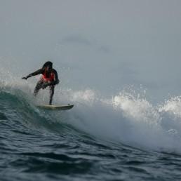 Khadjou Sambe, 25, Senegal's first female professional surfer, surfs during a training session off the coast of Ngor, Dakar, Senegal, August 18, 2020. REUTERS/Zohra Bensemra