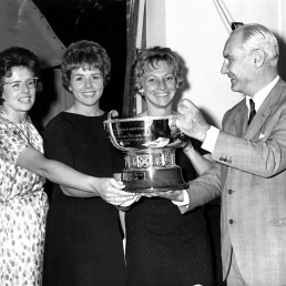 Dr George de Stefani, President of the IFLTA, awards the Federation Cup to the U.S. team who won the Ladies' International Competition, Darlene Hard, Carol Caldwell and Billie Jean Moffat, at the Queen's Club in London, Britain June 20, 1963. ITF Tennis/via REUTERS
