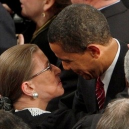 Supreme Court Justice Ruth Bader Ginsburg (L), who recently revealed that she is suffering from pancreatic cancer, gets a hug from President Barack Obama as he arrived for his primetime address to a joint session of Congress on Capitol Hill in Washington, February 24, 2009. REUTERS/Jim Young