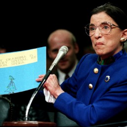 US Supreme Court nominee Ruth Bader Ginsburgh holds up a drawing of herself with the words