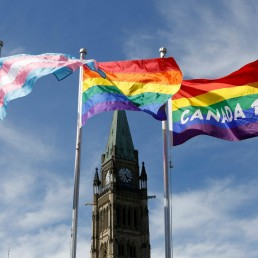 Canada reintroduces bill banning LGBT conversion therapy. The transgender pride (L), pride (C) and Canada 150 pride flags fly following a flag raising ceremony on Parliament Hill in Ottawa, Ontario, Canada, June 14, 2017. REUTERS/Chris Wattie