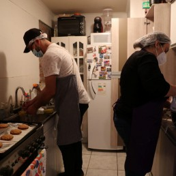 Pedro Campos, who lost his job last year when the restaurant where he worked closed after riots in Santiago broke out over social injustice and entrenched inequality, prepares to bake and sell homemade bread to his neighbours, as his wife Francisca prepares a cake, at their house at Puente Alto area, on the outskirts of Santiago, Chile October 6, 2020. Picture taken October 6, 2020. REUTERS/Ivan Alvarado