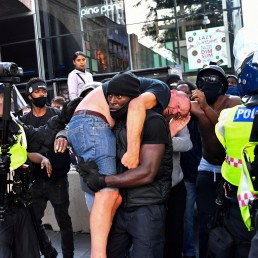 Prince Harry talks about racism with hero Patrick Hutchinson. Protester Patrick Hutchinson carries an injured counter-protester to safety, near the Waterloo station during a Black Lives Matter protest following the death of George Floyd in Minneapolis police custody, in London, Britain, June 13, 2020. REUTERS/Dylan Martinez