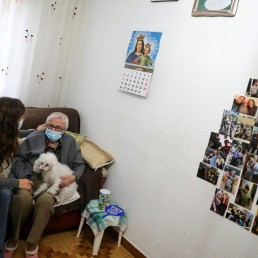 Florentina Martin, a 99 year-old woman who survived coronavirus disease (COVID-19), sits with her granddaughter Noelia Valle in her home in Pinto, near Madrid, Spain, October 20, 2020. Picture taken October 20, 2020. REUTERS/Sergio Perez