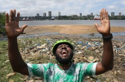 The Ivorian environmental activist Andy Costa also known as the cycling ambassador in Africa, reacts as he stand among plastic and other wastes at the shore of Ebrie Lagoon in Abidjan, Ivory Coast August 5, 2020. REUTERS /Luc Gnago