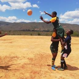 Sahumani Secondary rugby team coach Patricia-Mukunike-Chakanya is throwing the ball at Cathrine Muranganwa lifted by Trish Kandemiri and Velme Nyarumwe during a line-out at Sahumani Secondary, Honde Valley, September 11 2020, Thomson Reuters Foundation/Farai Shawn Matiashe