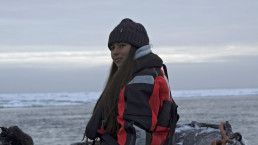 Environmental activist and campaigner Mya-Rose Craig, 18, sits on a boat in the middle of the Arctic Ocean, hundreds of miles above the Arctic Circle, September 20, 2020. REUTERS/Natalie Thomas