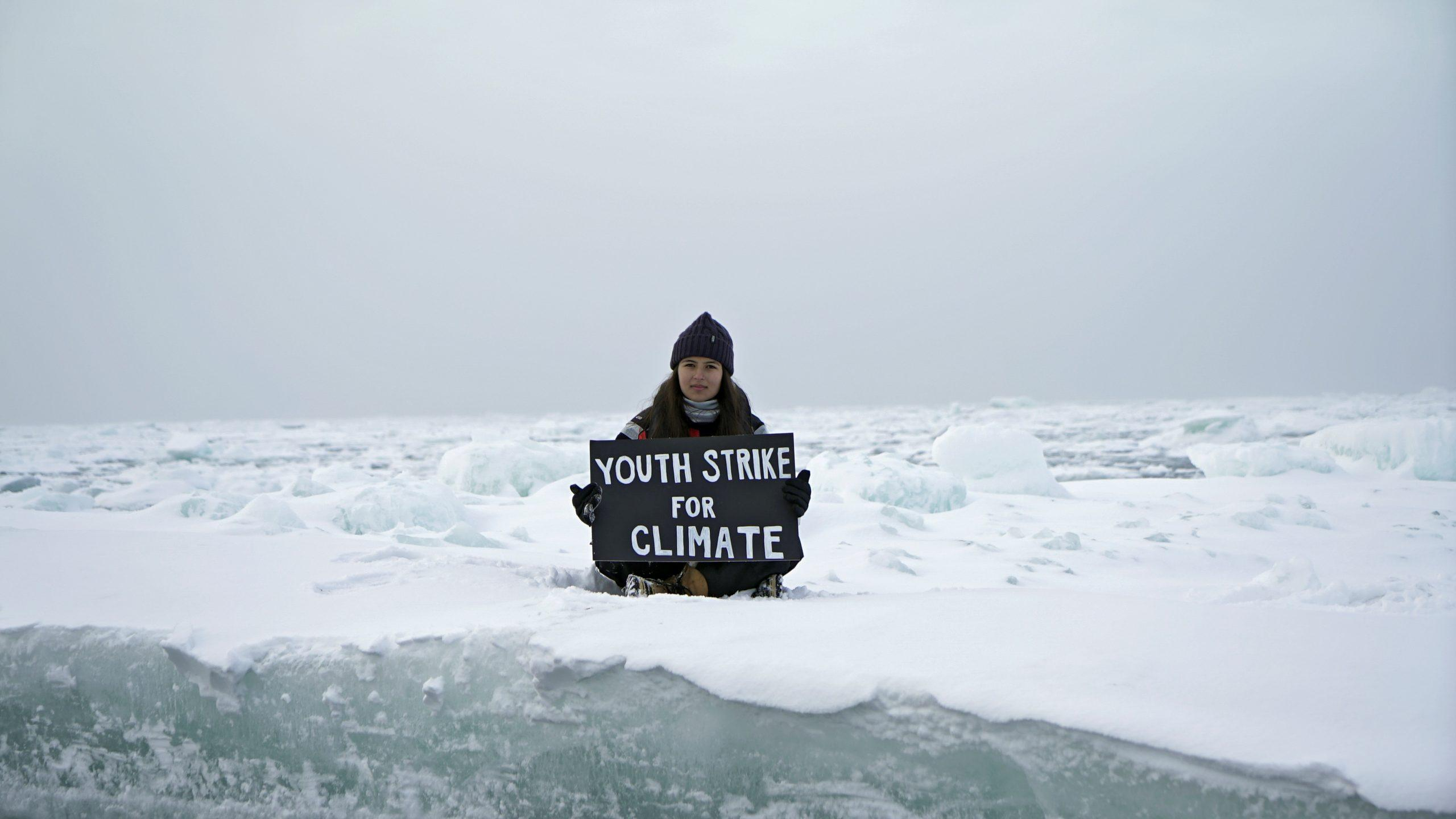 Teenage British activist stages climate protest on Arctic ice floe - GLOBAL HEROES MAGAZINE