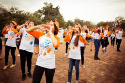 Fifty boys and girls of various ages wearing the orange Strong Hands t-shirts and caps put on a flash mob dancing in sync. It was one of the events that took place at the National University of Lao, Dong Dok campus on December 4th. It was a joint collaboration amongst UN Women, UNFPA, NCAW, NUOL, Fanglao and Hoppin.
