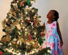 Albah staring at her first sparkly Christmas tree.