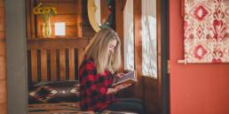 002GHN - Fall Glamping Woman reading